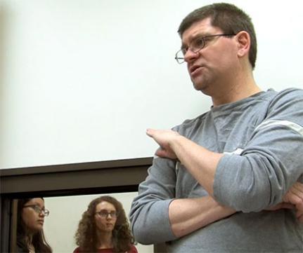 ProfessorTorrey Loucks advises students